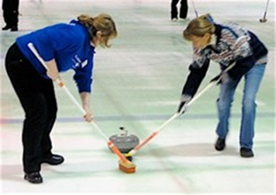 Women Curling on Ice